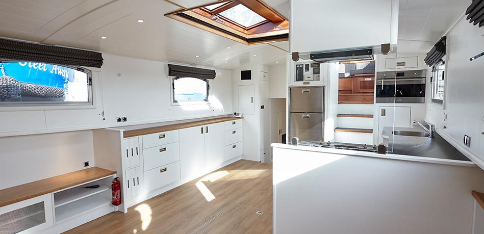 Piper Boats Bespoke designs internal galley kitchen Dutch Barge