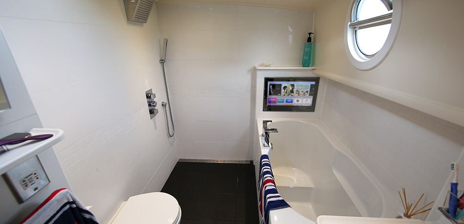 Piper Boats bespoke designs custom bathroom deep soaker bath tub full wet room